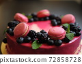 Delicious cake with fresh strawberries, raspberries, blueberry, currants. cut piece of cake and blade on wooden background. 72858728