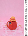 Sakura on a pink background, a red school bag made of clay, a yellow hat 72870569