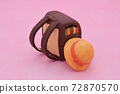 Brown school bag made of clay on pink background, yellow hat 72870570