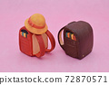 Red and brown school bag made of clay on pink background, yellow hat 72870571