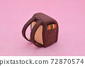 Brown school bag made of clay on a pink background 72870574