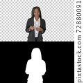 African American businesswoman explaining and gesturing while wa 72880091