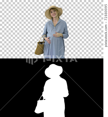 Attractive pregnant woman smiling and walking, Alpha Channel wit 72880095
