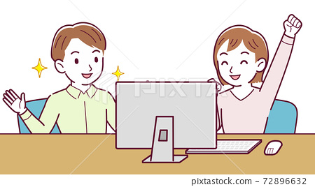 Two people talking while looking at a desktop 72896632