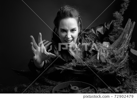 Angry girl stretches out her hand to the camera. 72902479