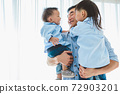 Happy father carrying two children in bedroom at home. Asian family living and having facial expression togetherness. Leisure time. People lifestyle health. Quarantine Covid-19 Coranavirus theme 72903201