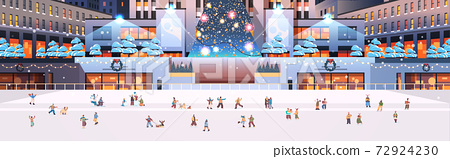 people skating on ice rink on central city square new year christmas winter holidays celebration concept 72924230
