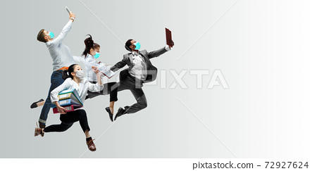 Happy office workers in face masks jumping and dancing in casual clothes or suit isolated on studio background. Creative collage. 72927624