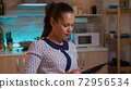 Businesswoman using tablet pc while working remotely 72956534