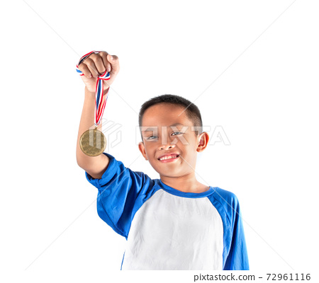 The boy shows the gold medal, Happy and proud. 72961116