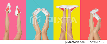Close-up slim female legs in sports shoes isolated on vibrant colors background. 72961427