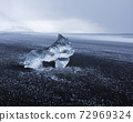 Ice Cube Sculpture at black volcanic Iceland Beach 72969324