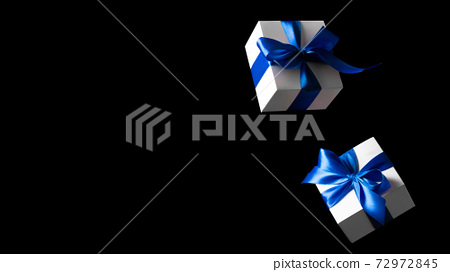 Black Friday. White gift box with blue ribbon isolated on black background in Black Friday concept. Winter flying composition with copy space. 72972845