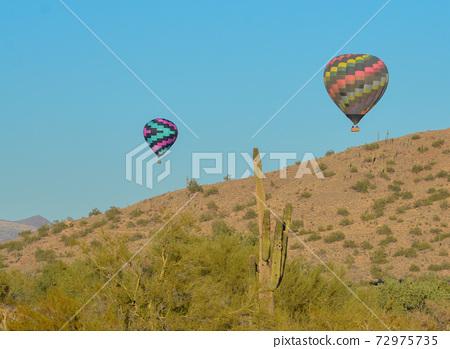 Peaceful flight over sunny Arizona in a brightly colored Hot Air Balloon. Maricopa County, Arizona 72975735