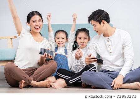 Family at home 72983273