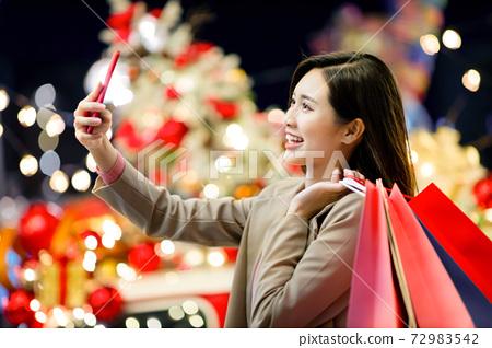 asian woman takes selfie 72983542