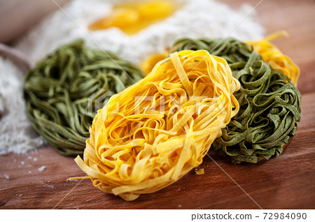 Bologna original Homemade tagliatelle pasta on a cutting board. 72984090