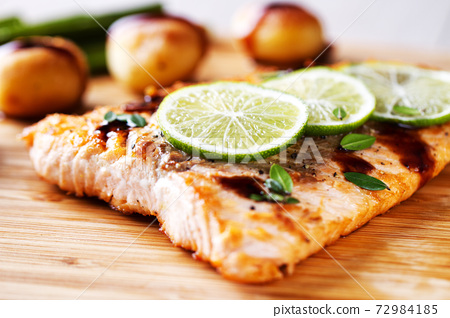Salmon Fillet with potatoes, Lime and Balsamic Sauce 72984185