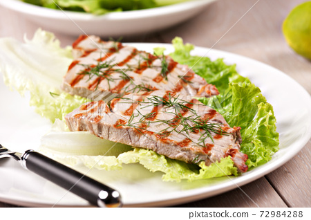 Grilled tuna with salad on a plate ready to eat. 72984288