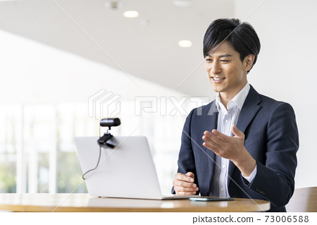 Image of businessman video call online conference talking to webcam 73006588