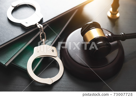 Crime and violence concept with handcuffs 73007728