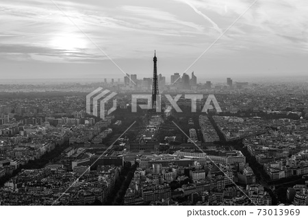 Aerial view of Paris with Eiffel tower and major business district of La Defence in background at sunset 73013969