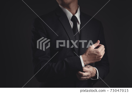 Close up shot of businessman in black suit. 73047015