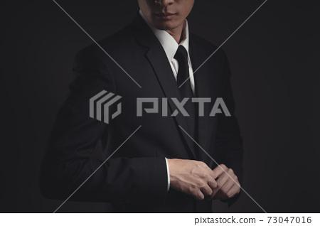 Close up shot of businessman in black suit. 73047016