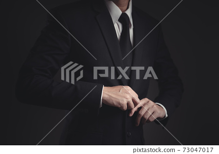 Close up shot of businessman in black suit. 73047017
