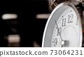 Big metallic clock close up. Time or showing time concept. Classic retro mechanical alarm clock 73064231