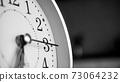 Black white big metallic clock close up. Time or showing time concept. Classic retro mechanical alarm clock 73064232