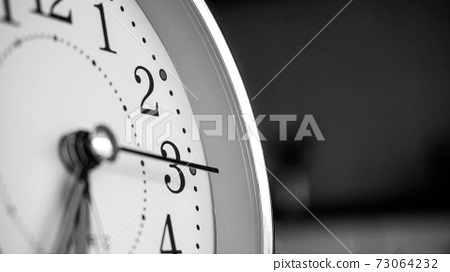 Black white big metallic clock close up. Time or showing time concept. Classic retro mechanical alarm clock 73064232