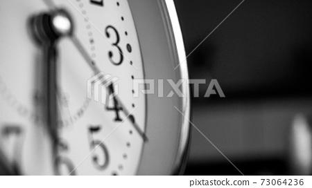 Black white big metallic clock close up. Time or showing time concept. Classic retro mechanical alarm clock 73064236