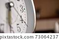 Big metallic clock close up. Time or showing time concept. Classic retro mechanical alarm clock 73064237