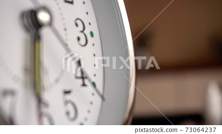 Big metallic clock close up. Time or showing time concept. Classic retro mechanical alarm clock 73064237