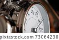 Big metallic clock close up. Time or showing time concept. Classic retro mechanical alarm clock 73064238