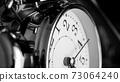 Black white big metallic clock close up. Time or showing time concept. Classic retro mechanical alarm clock 73064240