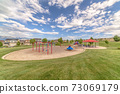 Playground with a scenic view of Mount Timpanogos and cloudy blue sky 73069179