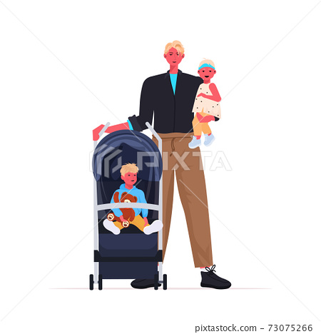 young father walking outdoor with daughter and baby son in stroller fatherhood parenting concept 73075266