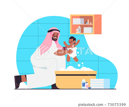 arab father bathing little son in bath tub fatherhood parenting concept dad spending time with baby at home 73075399