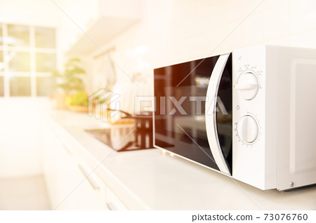 Kitchen counter closeup microwave oven cooking machine 73076760