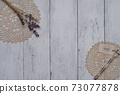 Fashionable dried flowers on a white board wall 73077878