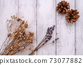 Fashionable dried flowers on a white board wall 73077882