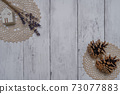 Fashionable dried flowers on a white board wall 73077883