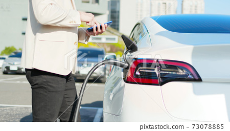 man Charges electric car 73078885