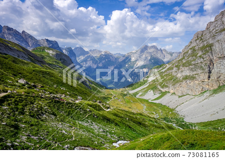 Mountain and hiking path landscape in French alps 73081165