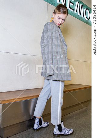 Young woman with blonde hair in the metro 73086414
