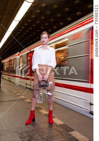 Young woman with blonde hair in the metro 73086521