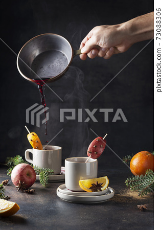 Hot mulled wine with steam 73088306