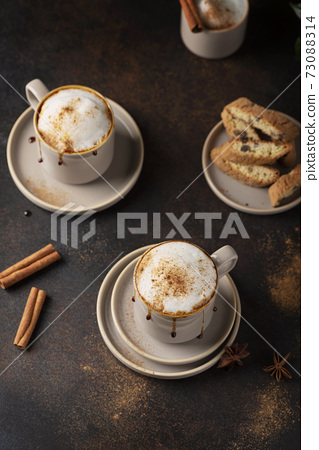 Hot winter cappuccino with cinnamon and caramel 73088314